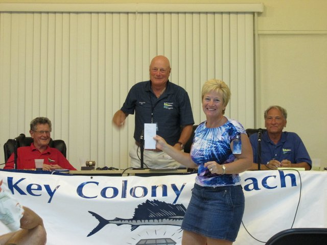 Cindy Casey accepts prizes for heaviest Mutton snapper and Amberjack in December