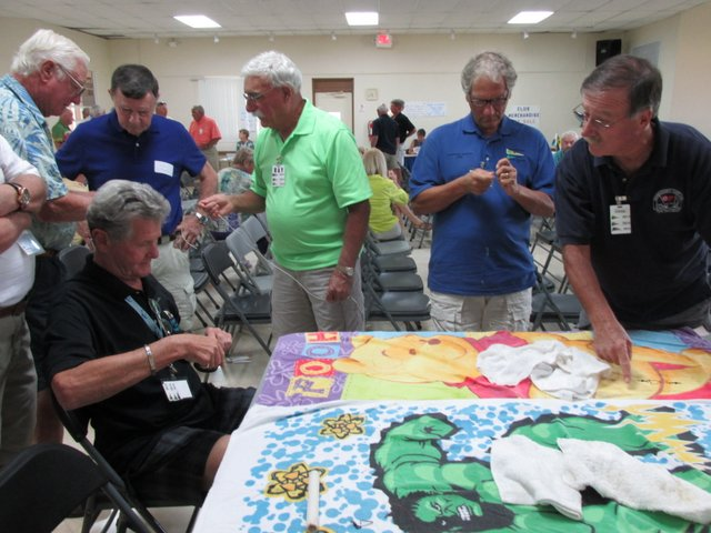 Dave Burnett hosted a seminar featuring a knot tying demonstration and contest, some of the contestants pictured here
